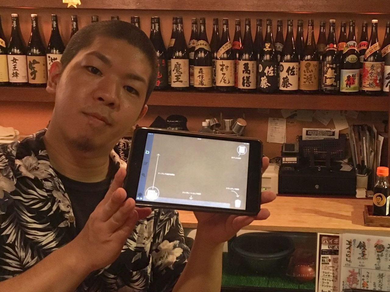 iPad POSレジ「ユビレジ」を持つ沖縄料理と地頭鶏 炎スタッフ様